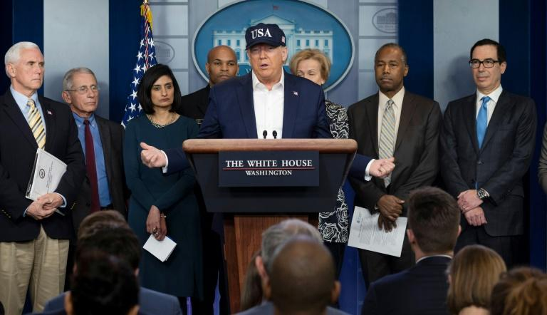 US President Donald Trump (C, pictured with members of the Coronavirus Task Force at the White House) reportedly is trying to poach German scientists working on an experimental vaccine against the virus