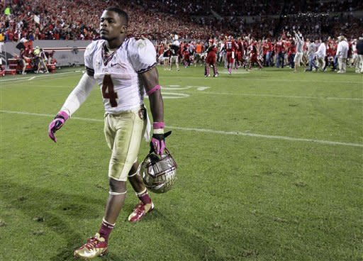 Florida State's Chris Thompson (4) walks off of the field following Florida State's 17-16 loss to North Carolina State in an NCAA college football game in Raleigh, N.C., Saturday, Oct. 6, 2012. (AP Photo/Gerry Broome)