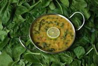 "<p>Indian food and dals go hand in hand. From North to South, East to the West of India, almost every family has its own version of cooking dal. Most of us grew up hearing from our mothers about how healthy dal is for our health and therefore its consumption absolutely necessary on days we got food fussy. Combining dal with spinach makes for a very interesting dish too. Simply add some chopped spinach to toor dal in the pressure cooker. Cover this with some water and add some salt and turmeric. Start the pressure cooker and heat until one whistle followed by additional 10 minutes on slow flame. Every family gives a different tadka to their dals. One of the more common ones is with oil, cumin seeds, asafoetida, red chilly powder and coriander powder. Make this and add over the dal once it cools down in the cooker and voila dal palak is ready. ""Creative Commons Dal Palak"" by Yummy O Yummy;is licensed under CC BY 2.0 </p>"