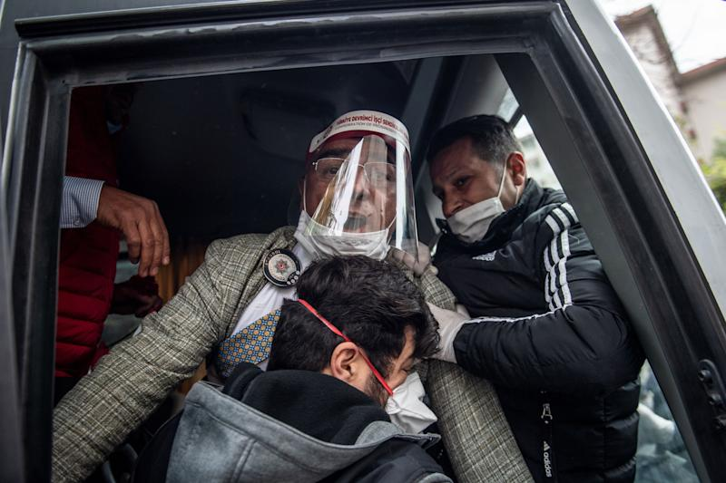 Police detain a demonstrator wearing a face masks for protection against coronavirus, Covid19, during a May Day rally marking the international day of the worker in Istanbul, on May 1, 2020, as the country tries to curb the spread of the coronavirus, COVID-19. - Police in Istanbul detained several demonstrators who tried to march toward Istanbul's symbolic Taksim Square to mark May Day in defiance of the lockdown imposed by the government due to the coronavirus outbreak. (Photo by Bulent Kilic / AFP) (Photo by BULENT KILIC/AFP via Getty Images)