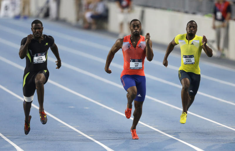 Tyson Gay, center, leads Justin Gatllin, left, and Charles Silmon during the senior men's 100-meter dash final at the U.S. Championships athletics meet, Friday, June 21, 2013, in Des Moines, Iowa. Gay won the race in 9.75 seconds. (AP Photo/Charlie Neibergall)