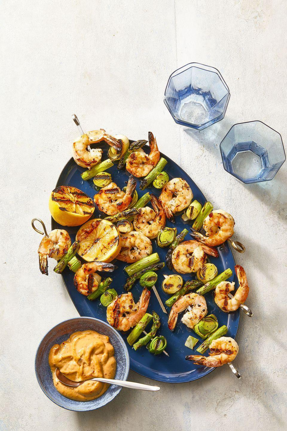 """<p>If you're grilling, these spring veggie-and-shrimp skewers are so simple to make.</p><p><a href=""""https://www.womansday.com/food-recipes/a36040238/charred-shrimp-leek-and-asparagus-skewers-recipe/"""" rel=""""nofollow noopener"""" target=""""_blank"""" data-ylk=""""slk:Get the recipe for Charred Shrimp, Leek and Asparagus Skewers."""" class=""""link rapid-noclick-resp""""><em>Get the recipe for Charred Shrimp, Leek and Asparagus Skewers.</em></a></p>"""