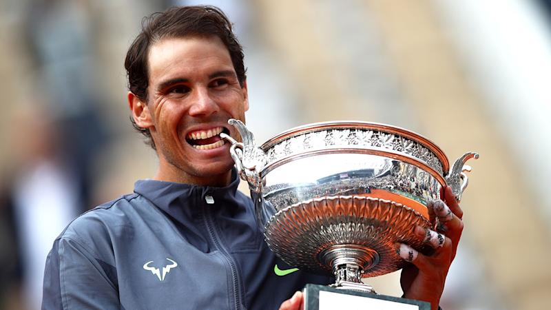 Seen here, Rafael Nadal poses with the 2019 French Open trophy.