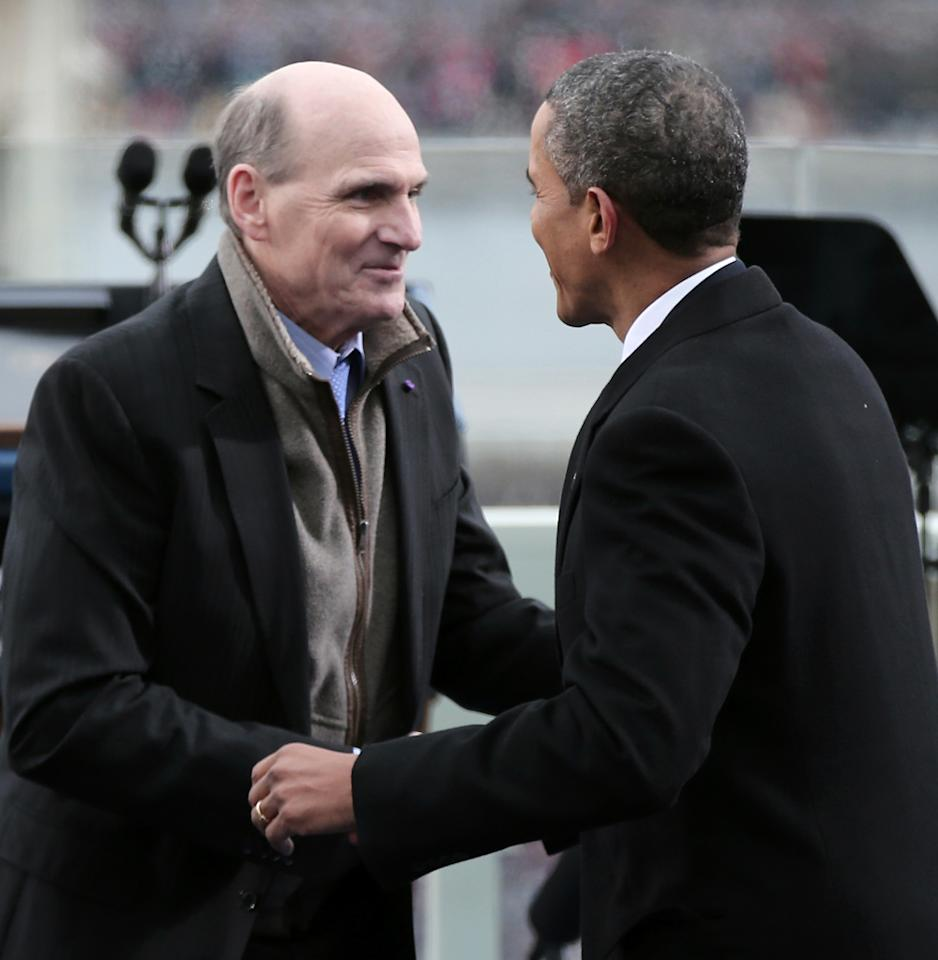 WASHINGTON, DC - JANUARY 21:  U.S. President Barack Obama greets singer James Taylor after his performance during the public ceremonial inauguration on the West Front of the U.S. Capitol January 21, 2013 in Washington, DC.   Barack Obama was re-elected for a second term as President of the United States.  (Photo by Win McNamee/Getty Images)
