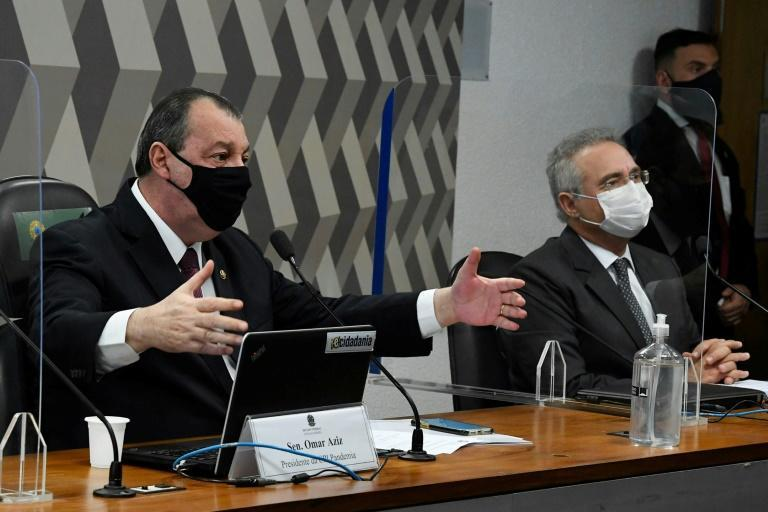 Brazilian senators Omar Aziz (left) and Renan Calheiros participate in the inquiry into the government's handling of the coronavirus pandemic on May 4, 2021