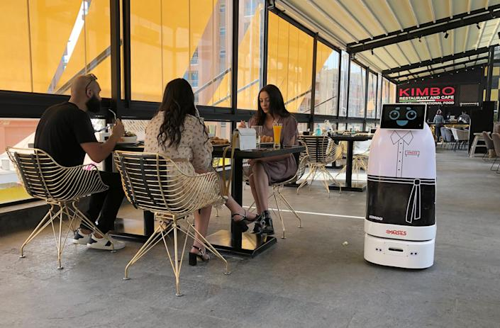 """'Mozo', a robot waiter of MARSES Robotic Solutions at Kimbo Restaurant & Cafe in Cairo, Egypt, on July 28, 2020. <p class=""""copyright"""">REUTERS/Ahmed Fahmy</p>"""