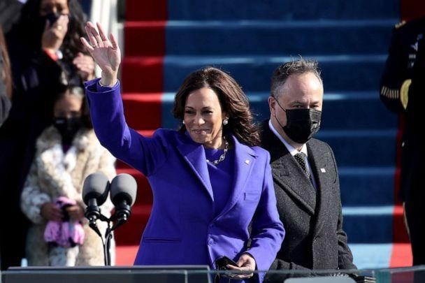 PHOTO: Newly sworn in Vice President Kamala Harris and her husband Doug Emhoff wave at the inauguration of President-elect Joe Biden on the West Front of the U.S. Capitol on Jan. 20, 2021, in Washington, D.C. (Rob Carr/Getty Images)