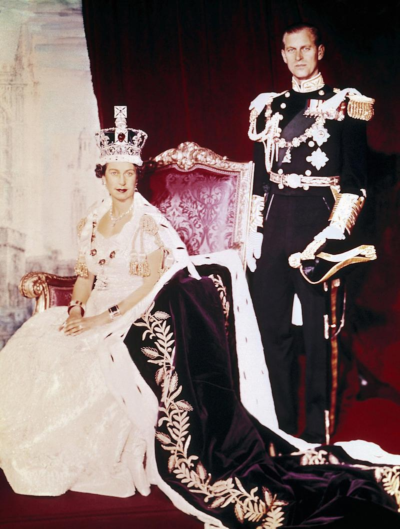 The Queen wearing her Norman Hartnell designed dress and robe on the day of her coronation - Getty