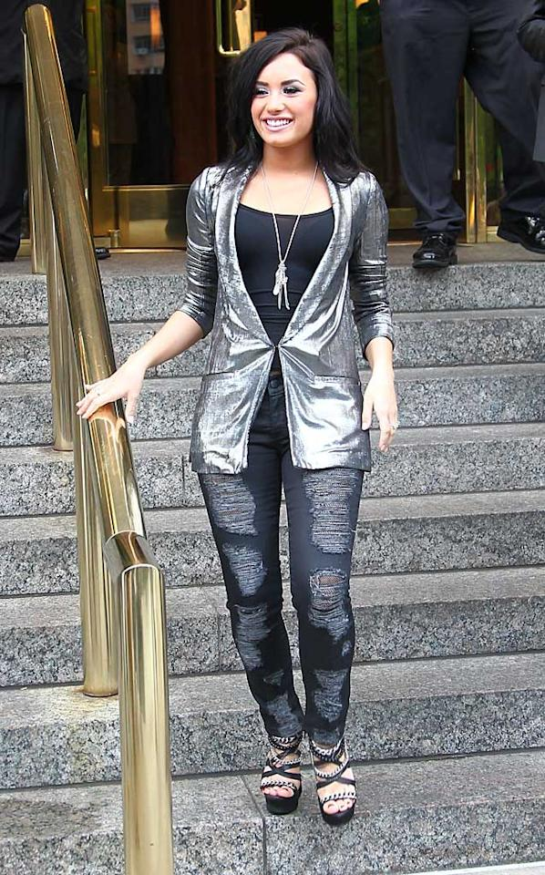 """If Demi Lovato continues to dress like a tacky version of the Tin Man, perhaps her boy toy, Joe Jonas, should consider sporting a Scarecrow-esque ensemble. <a href=""""http://www.infdaily.com"""" target=""""new"""">INFDaily.com</a> - May 19, 2010"""