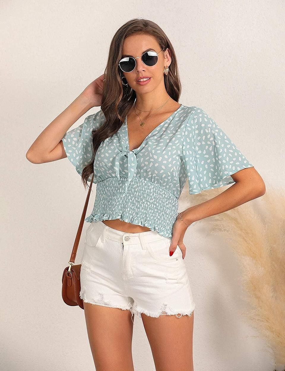 <p>How cute is this <span> Blooming Jelly Chiffon Blouse V Neck Front Tie Crop Top</span> ($9, originally $14)?! Style it with jeans or a pair of shorts. It's perfect for brunch and relaxing at the park.</p>