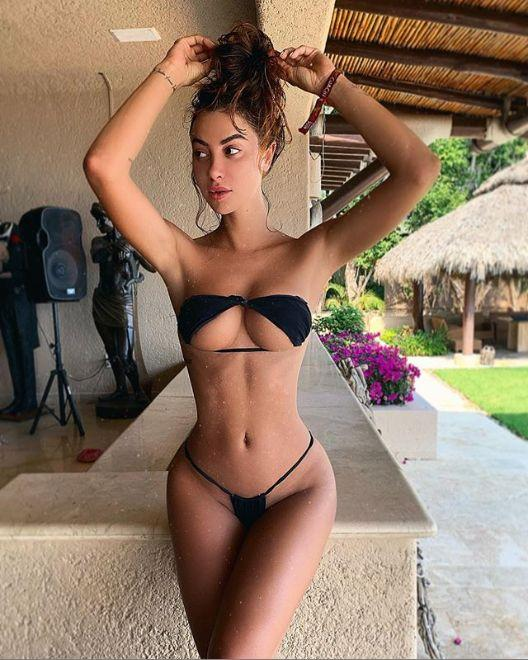 Model Valentina Fradegrada is the original upside down bikini poster.