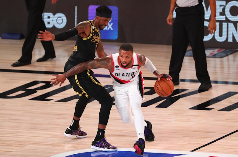 "Damian Lillard left Monday night's game after landing awkwardly on his knee, and will need to get a second MRI after the results of the first were ""inconclusive."" (Photo by Kim Klement-Pool/Getty Images)"