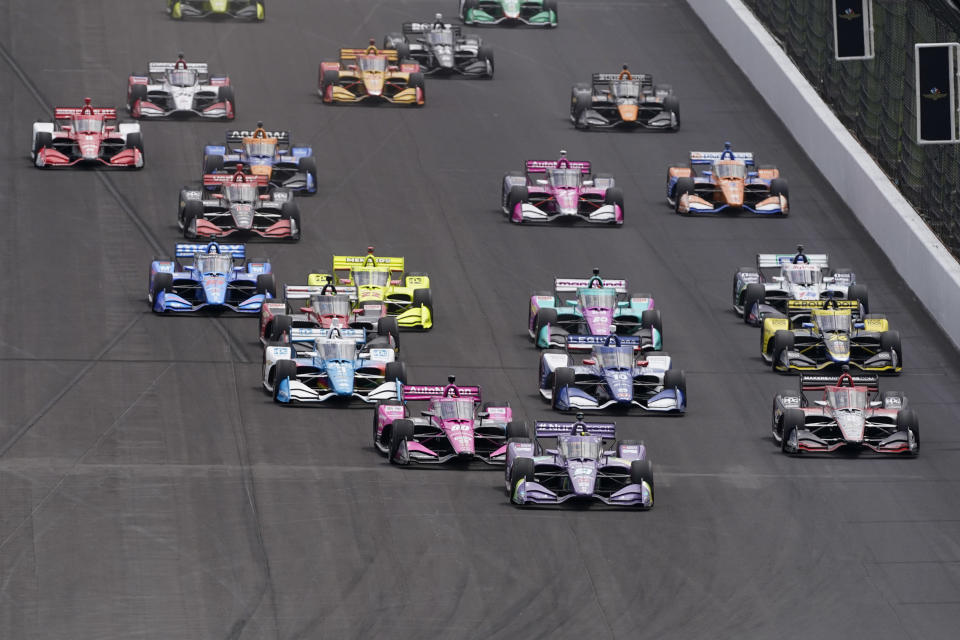 Romain Grosjean, of Switzerland, leads the field into turn one for the start of the IndyCar auto race at Indianapolis Motor Speedway, Saturday, May 15, 2021, in Indianapolis. (AP Photo/Darron Cummings)