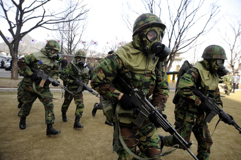 South Korean army soldiers take part in a civil defense drill against possible North Korea's attack in Seoul, South Korea, Tuesday, March 15, 2011. North Korea told a Russian envoy that it is willing to discuss its newly disclosed uranium enrichment program if long-stalled nuclear disarmament talks resume, state media reported Tuesday. (AP Photo/Bang Seung-hae)