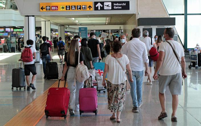 Rome's Fiumicino airport. Visitors from Britain will be able to show their UK vaccine certificates - EPA