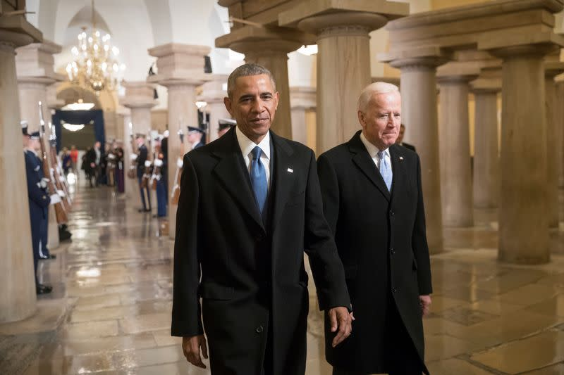 FILE PHOTO: President Barack Obama and Vice President Joe Biden walk through the Crypt of the Capitol in Washington