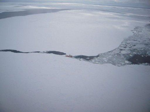 A United States Air Force photo from December 16, 2011 shows the Russian fishing boat Sparta stranded in the Antarctic. The nearest rescue vessels are still several days away and are being hampered from reaching the Sparta because of thick ice in the frozen Southern Ocean