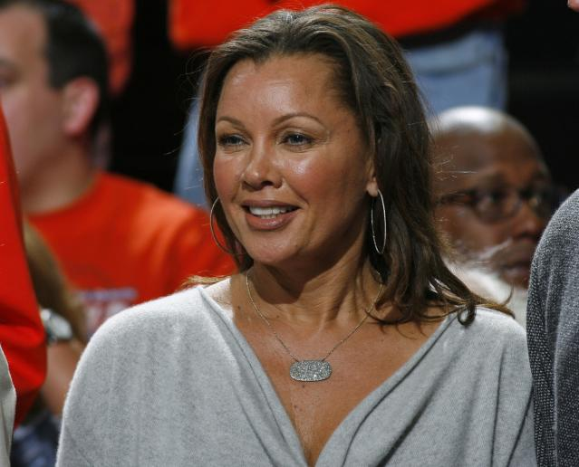 Vanessa Williams watches a game between Dayton and Syracuse during the NCAA men's college basketball tournament in Buffalo, N.Y., Saturday, March 22, 2014. (AP Photo/Bill Wippert)