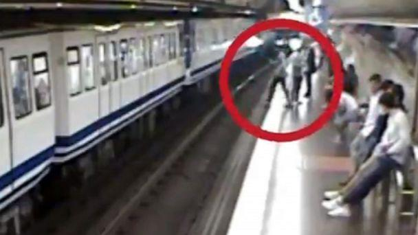 PHOTO: An image made from surveillance video released on Oct. 24, 2019, by Madrid Metro in Spain shows a woman looking at her phone as she steps off of the train platform and falls onto the track in front of an oncoming train. (Metro de Madrid/Twitter)