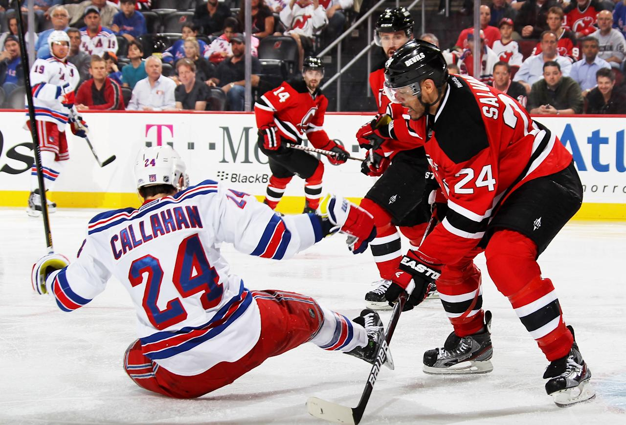 NEWARK, NJ - MAY 21:  Ryan Callahan #24 of the New York Rangers falls to the ice against Bryce Salvador #24 of the New Jersey Devils in Game Four of the Eastern Conference Final during the 2012 NHL Stanley Cup Playoffs at the Prudential Center on May 21, 2012 in Newark, New Jersey.  (Photo by Bruce Bennett/Getty Images)