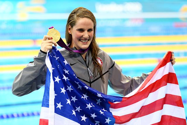 LONDON, ENGLAND - JULY 30: Missy Franklin of the United States celebrates with her gold medal and an American flag during the medal ceremony for the Women's 100m Backstroke on Day 3 of the London 2012 Olympic Games at the Aquatics Centre on July 30, 2012 in London, England. (Photo by Al Bello/Getty Images)