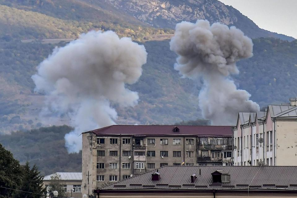 Smoke rises after shelling in Stepanakert during ongoing fighting between Armenia and Azerbaijan: AFP via Getty Images