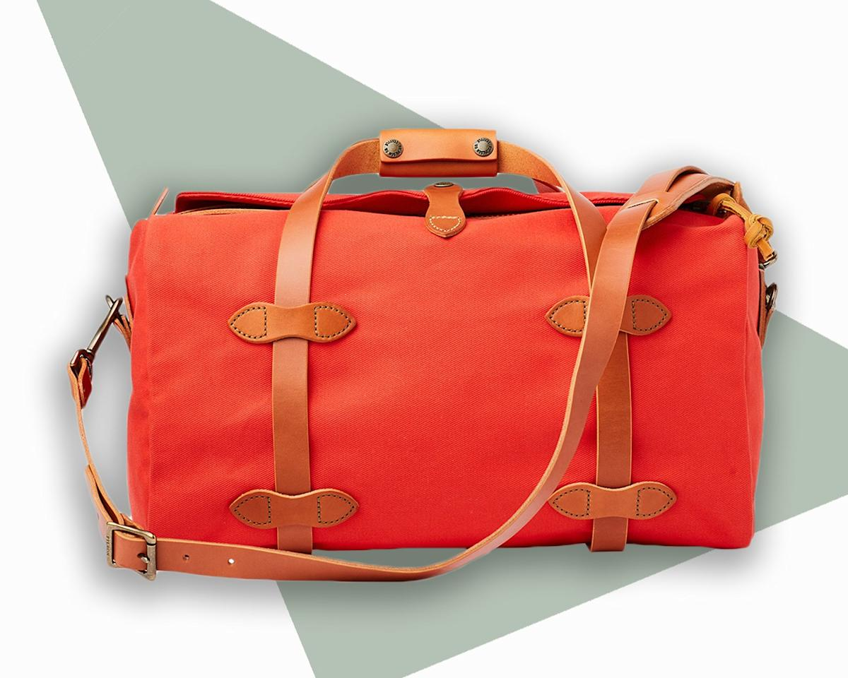 """<p>No one wants to worry about their bag holding up against the elements—or the whims of baggage handlers. Thanks to weather- and abrasion-resistant twill and saddle-grade bridle leather handles, this durable duffle will withstand all kinds of wear and tear, and still age beautifully over time. Fun fact: The limited-run vibrant shade is inspired by the heritage brand's iconic, patented Mackinaw Wool jacket.</p> <p><strong>Buy now:</strong> $350, <a href=""""https://fave.co/33eirGf"""" rel=""""nofollow"""">filson.com</a></p>"""