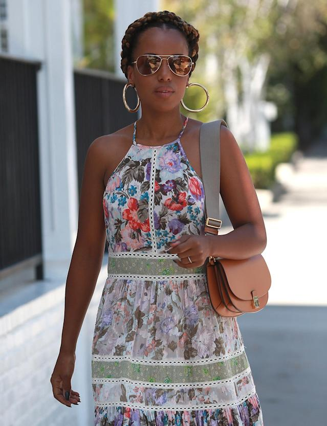 <p>Washington has been pretty low-key while taking a break from <em>Scandal</em>. But clearly she's enjoying summer with her braided crown updo and natural makeup. (Photo: Splash News) </p>