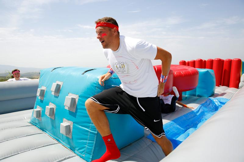 David running through the obstacle course.