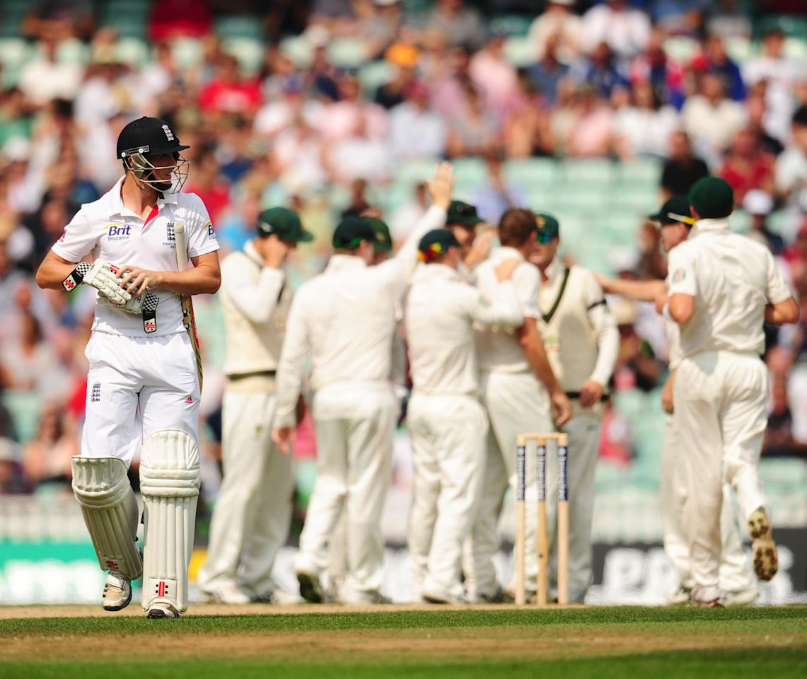 England's Chris Woakes leaves the field after being bowled by Australia's Ryan Harris during day five of the Fifth Investec Ashes Test match at The Kia Oval, London.