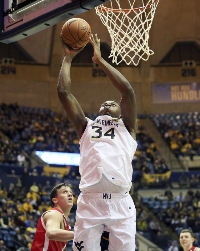 West Virginia's Oscar Tshiebwe (34) shoots during the second half of the team's NCAA college basketball game against Boston University on Friday, Nov. 22, 2019, in Morgantown, W.Va. (AP Photo/Kathleen Batten)