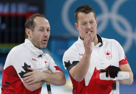 Curling - Pyeongchang 2018 Winter Olympics - Men's Bronze Medal Match - Switzerland v Canada - Gangneung Curling Center - Gangneung, South Korea - February 23, 2018 - Second Brent Laing of Canada and lead Ben Hebert of Canada talk during the match. REUTERS/John Sibley