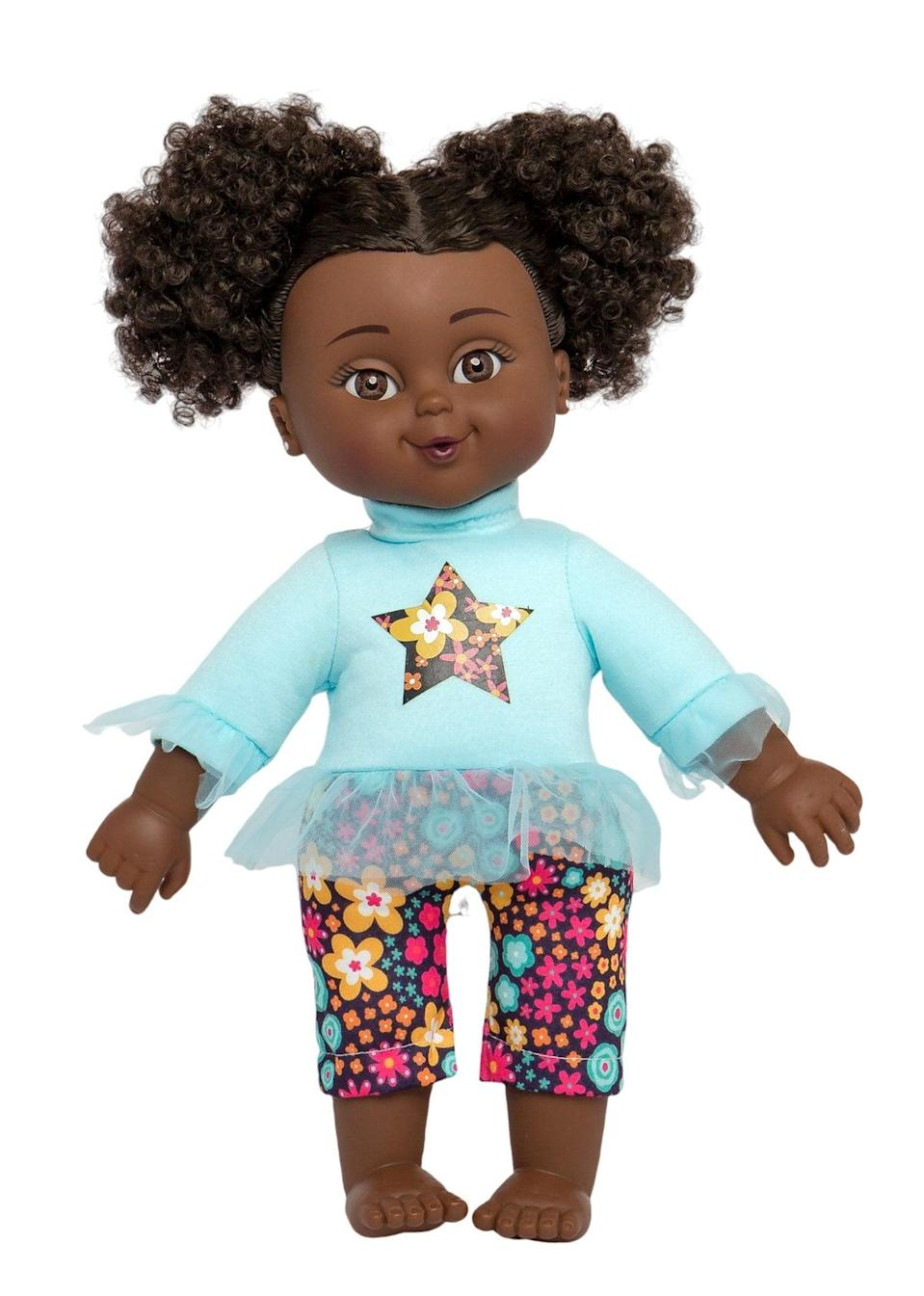 """<p>With a soft body, the <a href=""""https://www.popsugar.com/buy/Positively-Perfect-Curly-Afro-Puffs-Baby-Doll-579585?p_name=Positively%20Perfect%20Curly%20Afro%20Puffs%20Baby%20Doll&retailer=thefreshdolls.com&pid=579585&price=26&evar1=moms%3Aus&evar9=47528625&evar98=https%3A%2F%2Fwww.popsugar.com%2Ffamily%2Fphoto-gallery%2F47528625%2Fimage%2F47528646%2FPositively-Perfect-Curly-Afro-Puffs-Baby-Doll&list1=kid%20shopping&prop13=mobile&pdata=1"""" rel=""""nofollow noopener"""" class=""""link rapid-noclick-resp"""" target=""""_blank"""" data-ylk=""""slk:Positively Perfect Curly Afro Puffs Baby Doll"""">Positively Perfect Curly Afro Puffs Baby Doll</a> ($26) is the perfect companion for bedtime. </p>"""