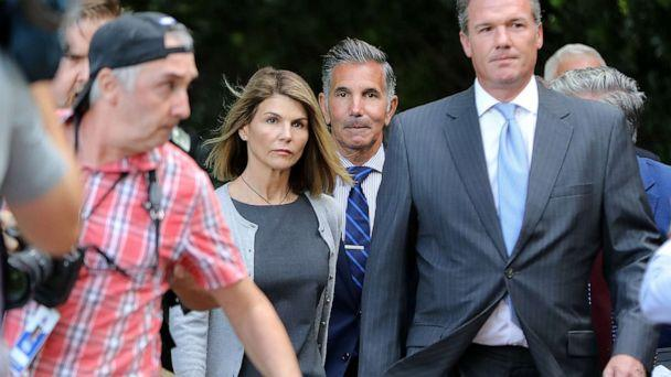 PHOTO: Lori Loughlin and her husband Mossimo Giannulli leave the John Joseph Moakley United States Courthouse in Boston, Aug. 27, 2019. (Pat Greenhouse/The Boston Globe via Getty Images)