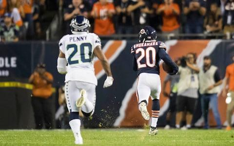 Chicago Bears defensive back Prince Amukamara (20) runs an interception of a pass intended for Seattle Seahawks running back Rashaad Penny (20) in for a touchdown during the second half  - Credit: Patrick Gorski/USA Today