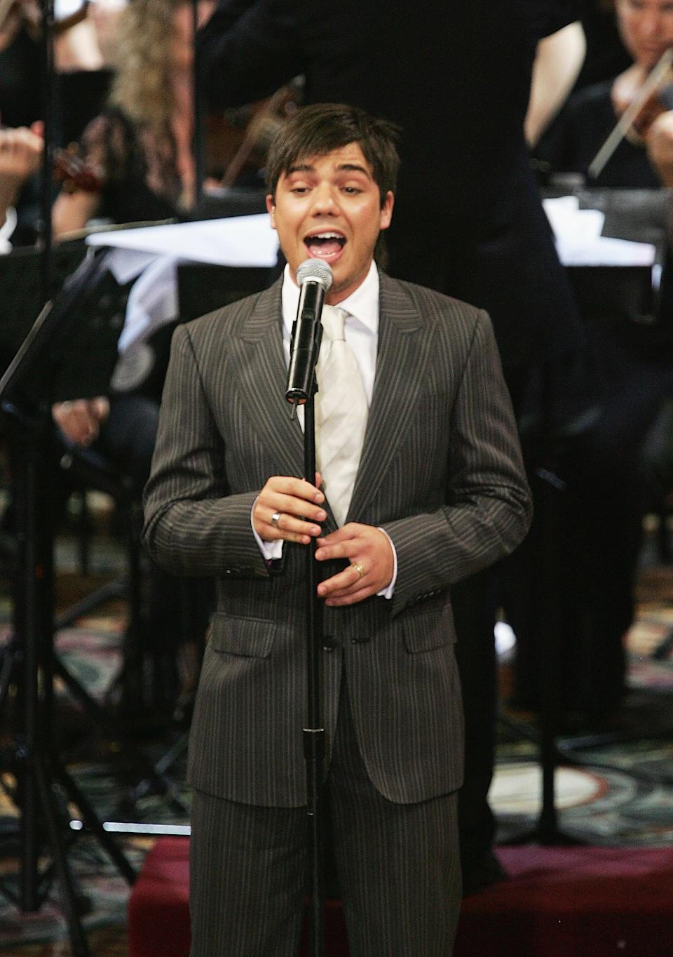 Singer Anthony Callea performs in front of Her Majesty Queen Elizabeth II during the Commonwealth Day Service at St Andrew's Cathedral on March 13, 2006 in Sydney, Australia