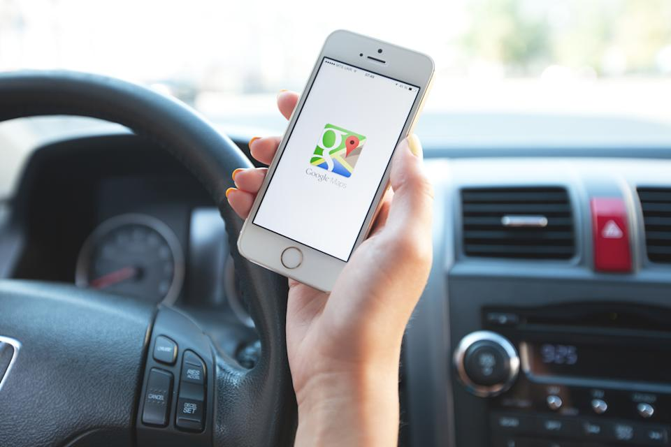 Kharkiv, Ukraine - August 2, 2014: Google Maps Navigation software in use on an Apple iPhone 5s. iPhone is product Apple Inc. Google Maps is a most popular web mapping service application and technology provided by Google inc.