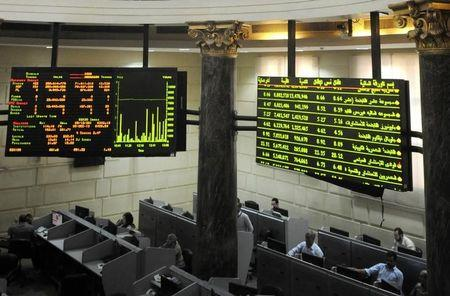 Traders work at Egypt's Stock Exchange in Cairo