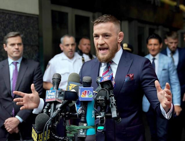 Conor McGregor reached a plea deal on assault charges stemming from an April incident in which he threw objects at a charter bus full of UFC fighters and employees. (Getty Images)