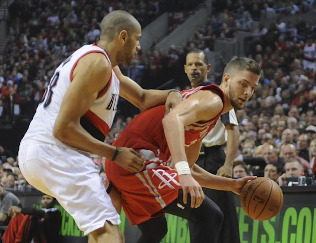 Houston Rockets' Chandler Parsons (25) works against Portland Trail Blazers' Nicolas Batum (88) during the first half of game four of an NBA basketball first-round playoff series game in Portland, Ore., Sunday March 30, 2014. (AP Photo/Greg Wahl-Stephens)