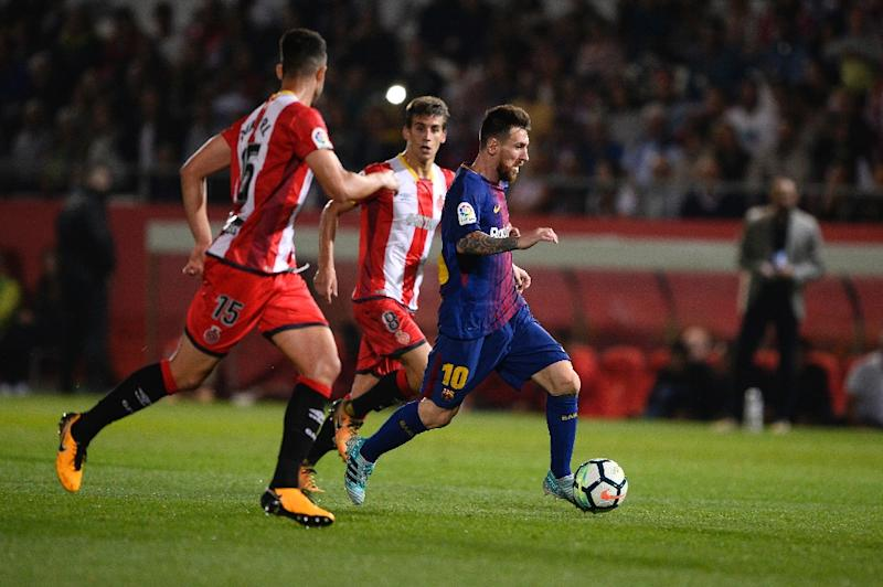 Two own goals help Barca to secure Catalan derby win
