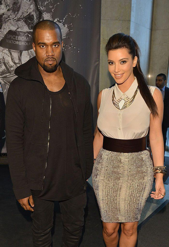 <p>West supports Kardashian at an event for a jewellery line in Canada in May 2012.</p>