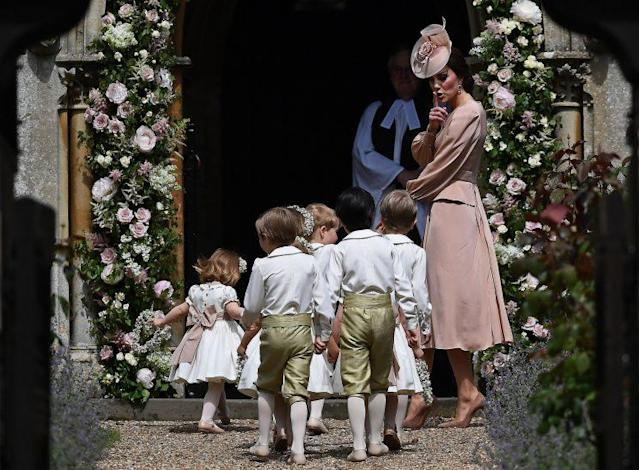 Kate Middleton keeps the children in line. (Photo: PA)