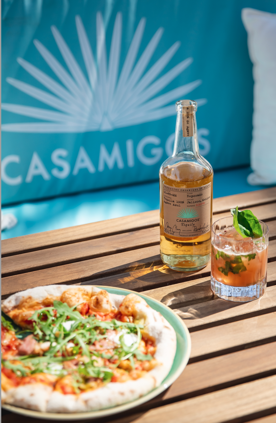 """<p>A collaboration between The Botanist Sloane Square and Casamigos Tequila and Mezcal, 'Pizza on the Square' is introducing an alfresco dining terrace in the heart of Sloane Square. The pop-up will serve woodfired pizzas – from garlic and mushroom white pizza or Caponata - and tequila cocktails, draft beers, non-alcoholic cocktails and champagne until September. </p><p>For the uninitiated, Casamigos was the boozy brainchild of George Clooney, Rande Gerber and Mike Meldman. This summer mixologists from the Botanist will be creating cocktails (sold for £12.50) such as Tommy's Casa Caliente and Cantartio Amigos.</p><p>Address: No. 7 Sloane Square, London, SW1W 8EE</p><p><strong>Click <a href=""""https://www.thebotanistonsloanesquare.com/"""" rel=""""nofollow noopener"""" target=""""_blank"""" data-ylk=""""slk:here"""" class=""""link rapid-noclick-resp"""">here</a> for more information. </strong></p>"""