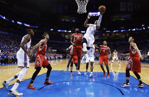 Oklahoma City Thunder guard Russell Westbrook (0) shoots in front of Houston Rockets guard James Harden in the first quarter of Game 1 of their first-round NBA basketball playoff series in Oklahoma City, Sunday, April 21, 2013. (AP Photo/Sue Ogrocki)