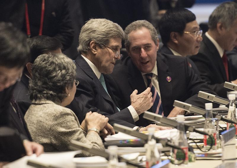 US Secretary of State John Kerry speaks with US Trade Representative Michael Froman before the opening session of the Asia-Pacific Economic Cooperation meeting in Beijing on November 7, 2014