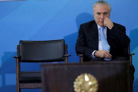 Brazil's President Michel Temer reacts during a ceremony to mark the signing of a decree on new regulations for beef inspection, at the Planalto Palace in Brasilia, Brazil March 29, 2017. REUTERS/Ueslei Marcelino