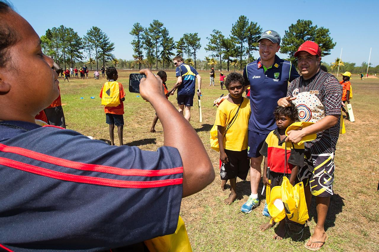 DARWIN, AUSTRALIA - AUGUST 10: Ricky Ponting of the Australian cricket team poses for photos with locals during a visit to Pirlangimpi of the Tiwi Islands on August 10, 2012 on the Tiwi Islands, Australia.  (Photo by Mark Nolan/Getty Images)