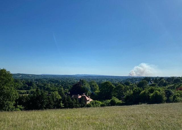 A fire on Thursley Common as seen from 11 miles away at Pewley Down park in Guildford