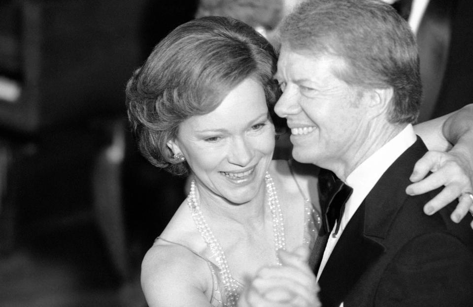 FILE - In this Dec. 13, 1978 file photo, President Jimmy Carter and his wife Rosalynn lead their guests in dancing at the annual Congressional Christmas Ball at the White House in Washington. Jimmy Carter and his wife Rosalynn celebrate their 75th anniversary this week on Thursday, July 7, 2021. (AP Photo/Ira Schwarz, File)